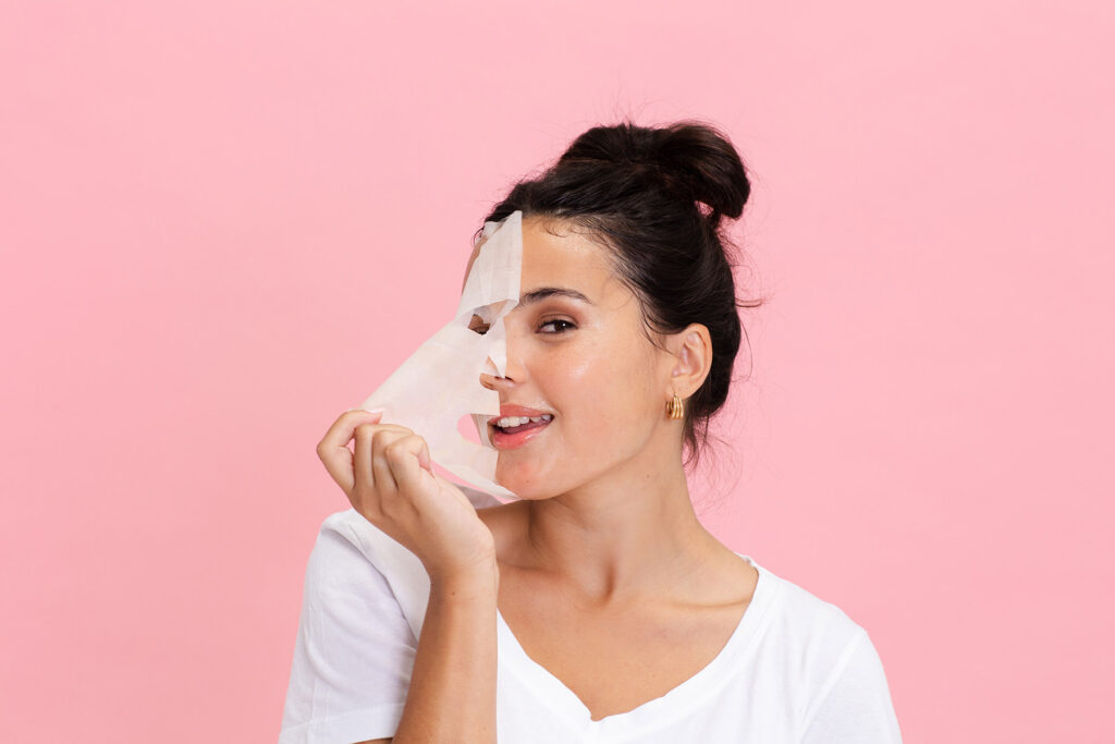 Girl removing face mask and smiling copy
